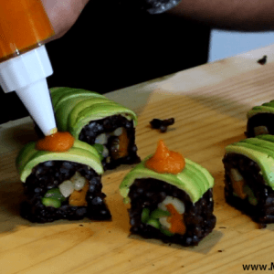 adding-carrot-sauce-to-the-vegan-sushi-roll